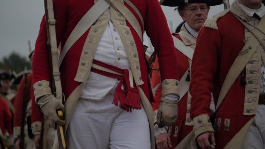 VIRGINIA - OCTOBER 2014 - Reenactment, large-scale, epic American Revolutionary War anniversary recreation -- British Redcoat  Army Soldiers in formation in camp. Cannons, Cavalry, Muskets, drill