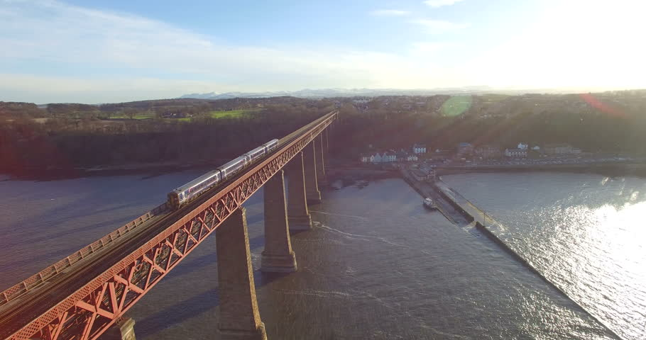 Aerial: Train on Forth Rail Bridge in Queensferry, Edinburgh, Scotland