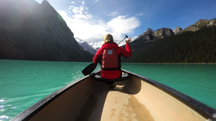 View of female Kayaking Lake Louise Alberta Canada
