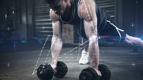 Slow motion of athlete performing push ups with dumbbell against the animated background