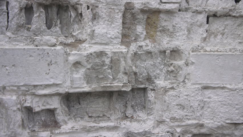 Panorama Of White Chipped Brick Wall Close Up