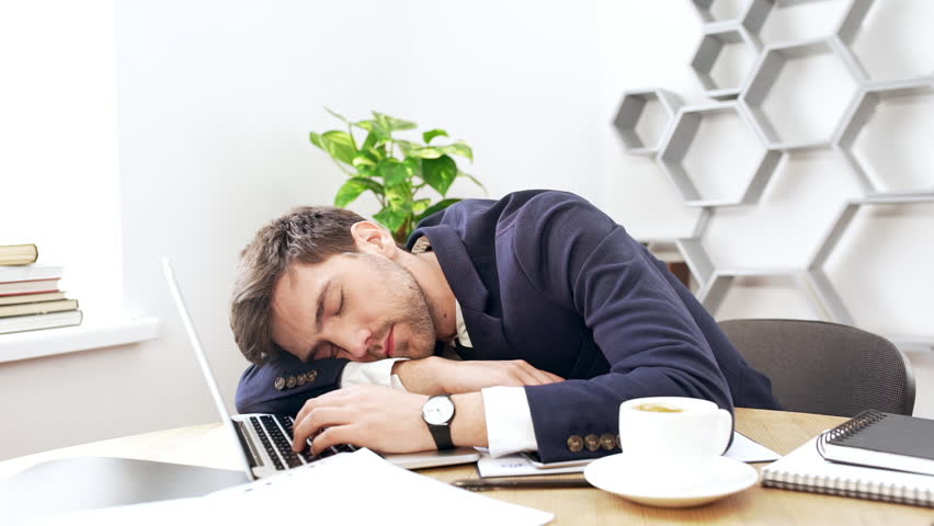 Young Successful Businessman Falling Asleep At His Workplace In Office Slow Motion Stock Footage Video 18357934 Shutterstock