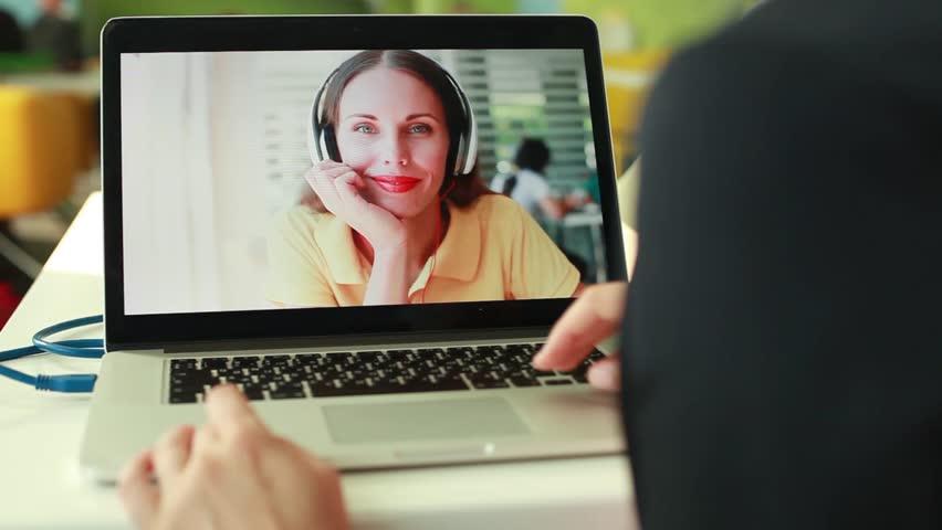 Woman doing videocall using laptop | Shutterstock HD Video #18387385