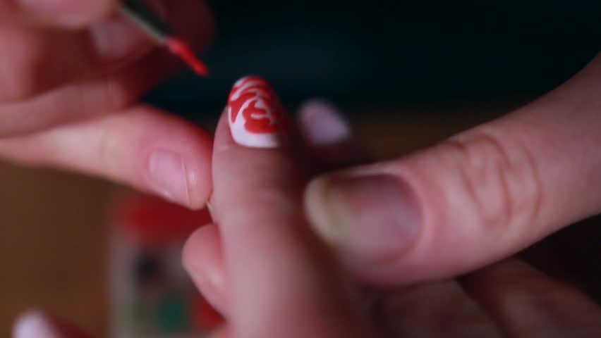 Woman in a Beauty Salon receiving a manicure | Shutterstock HD Video #18432664
