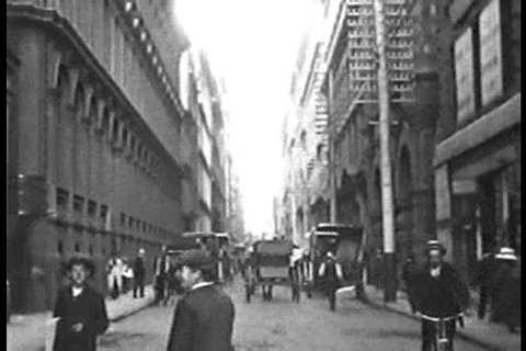A look at Little Collins Street foot traffic, horse and buggies, and men\xEAs fashion in Melbourne, Australia in 1910. (1910s)