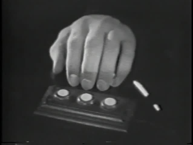 Close-up of shaking hand pushing button