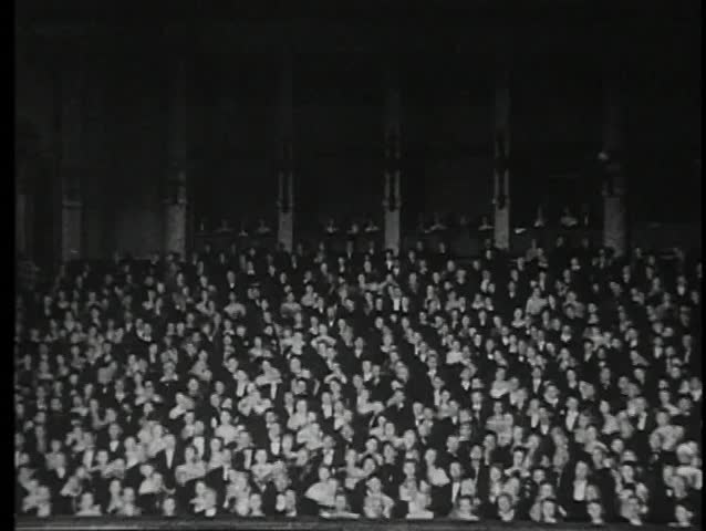 Wide shot of audience in  theater