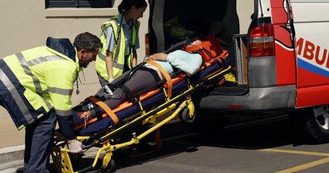 ambulance team carried the injured woman away on stretchers inside ambulance car