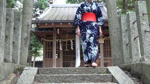 Yukata girl walking around Kyoto Shrine