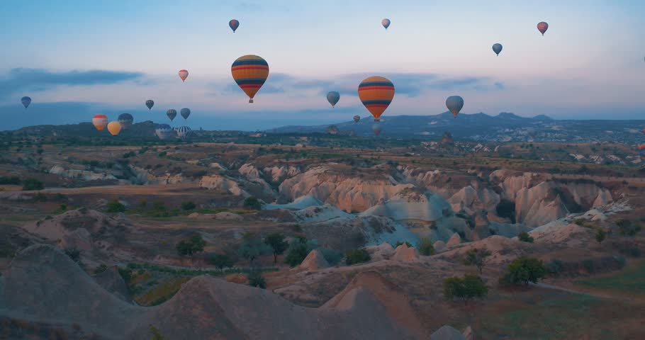 4K Aerial view of Goreme. Colorful hot air balloons flying over the valleys on July 2016, Famous city Cappadocia, Turkey.