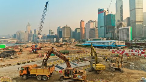 Operation of construction equipment during putting up skyscraper on the background of a megacity Hong Kong, timelapse