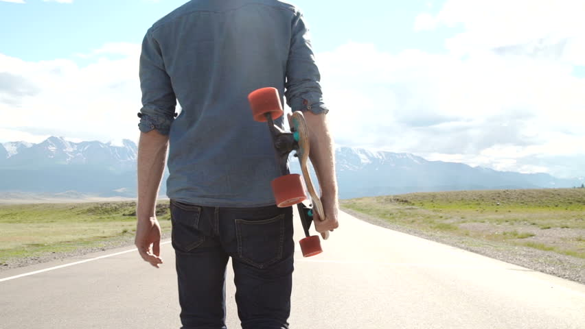 sport, leisure, people and teenage concept - smiling young man or teenager with longboard on mountain road. #18637364