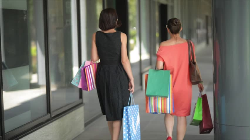Happy friends with shopping paperbags walking in the city, beautiful women leaving mall after a successful shopping | Shutterstock HD Video #18662954