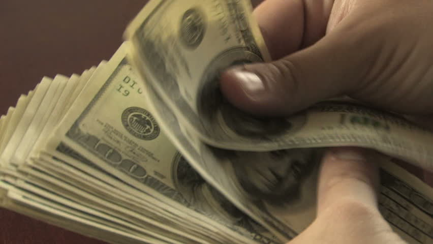 Close-up of a businessman's hands counting hundred  dollar bills at a table  #186730