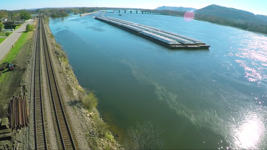 A very good aerial of a large coal barge going up the Mississippi River. (Mississippi River 2010s)