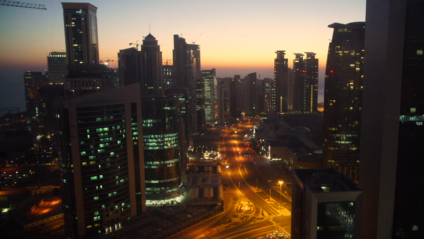 Panning across the new skyline of the West Bay central financial district of Doha, at sunrise, Doha. Qatar, Middle East