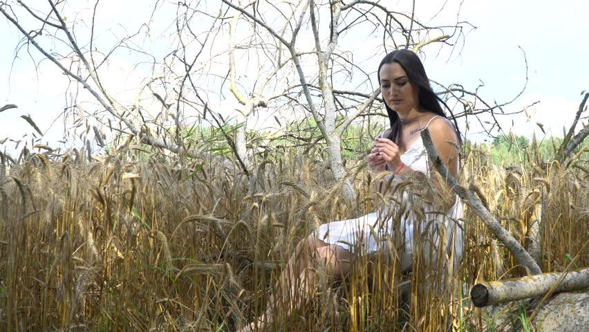 Woman brunette with a nice view. white summer dress | Shutterstock HD Video #18747224