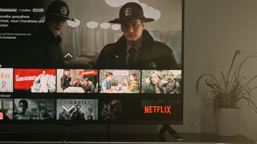 AACHEN, GERMANY - August 13, 2016 : Netflix app on LG Smart TV. Browsing the movie video library what new series to watch.