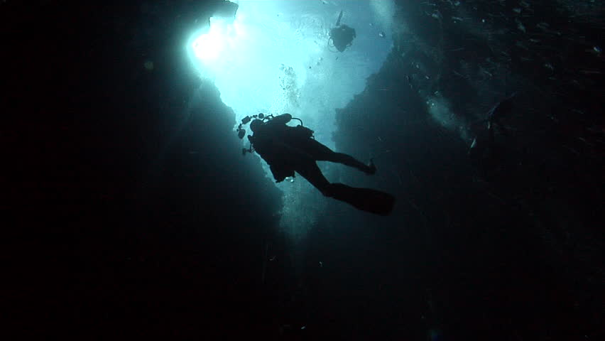 Group of scuba divers descending on deep water wall and cavern tunnel in Palau, Micronesia, HD, UP32792 | Shutterstock HD Video #18798851