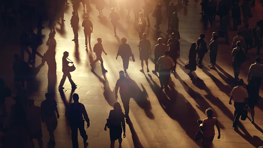 silhouette of unrecognizable people commuting in the city. crowded metropolis street scenery background