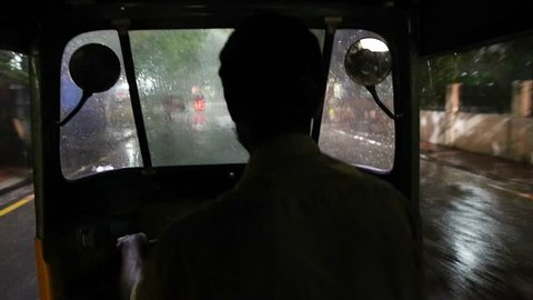 CHENNAI,INDIA - CIRCA August 2016 :Shot of Chennai pouring rain through rickshaw windshield at night