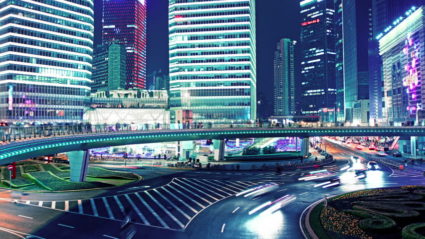 the light trails of city traffic on the modern building background in shanghai china. timelapse