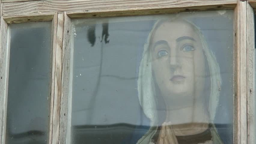 vintage wooden figure of virgin Mary under the glass