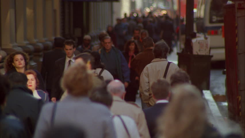 Day crowded sidewalk, people coats jackets cold weather right, New York rake Tilt up | Shutterstock HD Video #18915242