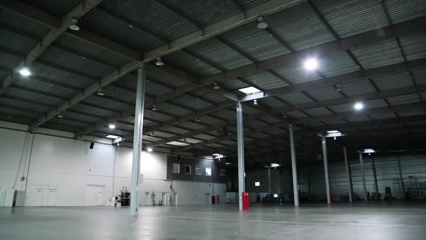 Big storage room. Inside of empty warehouse