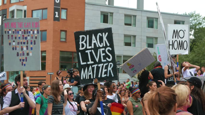 MONTREAL, CANADA - August 2016 : African American woman holding ''black lives matter''sign during a protest