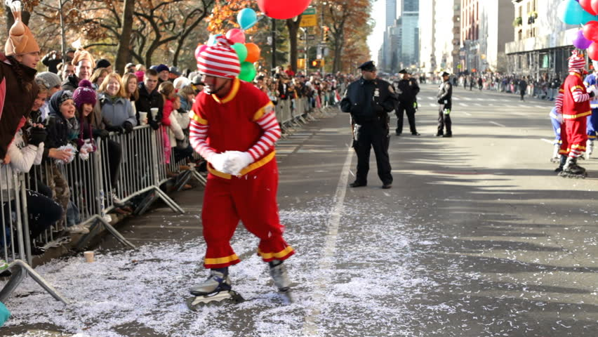 NEW YORK CITY, NY - NOVEMBER 24: Clown Rollerblader with crowd during Macy's Thanksgiving Day Parade on November 24, 2011 in New York City, New York.