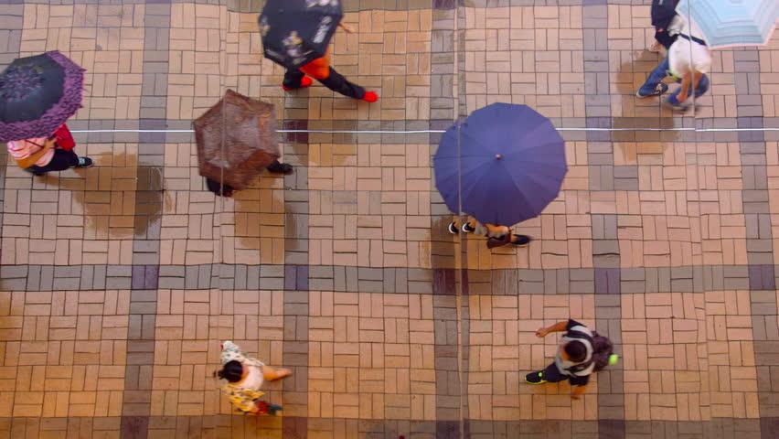 Mirrored Reflection Looking Down On Pedestrians With Umbrellas; Tsim Sha Tsui Kowloon Hong Kong China | Shutterstock HD Video #18956414