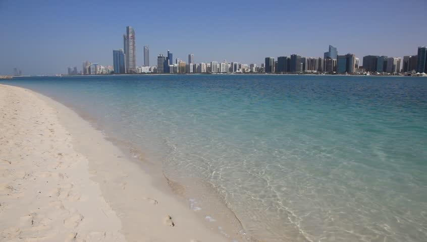 Beach and Abu Dhabi skyline, United Arab Emirates