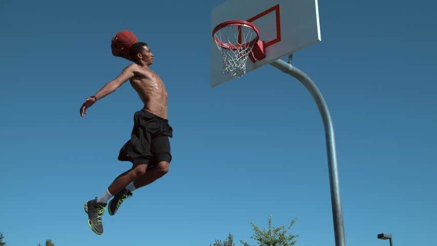 Super slow motion shot of basketball basketball slam dunk, shot on Phantom Flex 4K