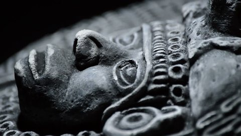 Sculpture in stone of face and ornaments of ancient art south american aztec, inca, olmeca
