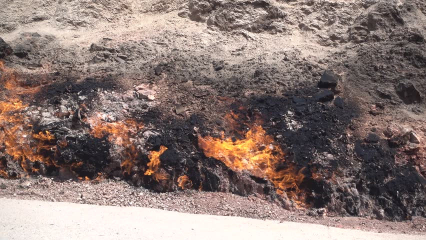 YANAR DAG, AZERBAIJAN, JULY 21, 2016. The natural gast fire burning, coming from ground through a rock in Yanar Dag, Azerbaijan, on July 21st, 2016.