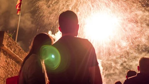Young Couple Watching Beautiful Fireworks Display 4Th Of July New Years Eve Celebration Vent Love Romantic Date Relationship Happiness Concept