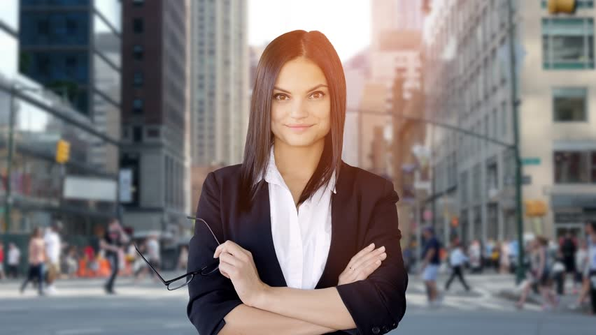 Portrait of young attractive business women smiling at camera standing in the city. professional sales people background | Shutterstock HD Video #19067704