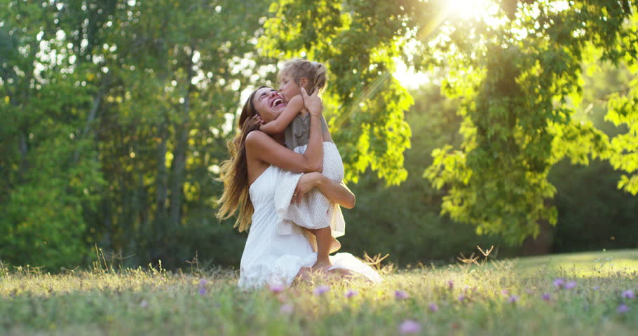 ecology, young mother with her adorable two year old girl playing outdoors with love. concept of family love of nature. happy children with the love of parents. concept of green and sustainability.