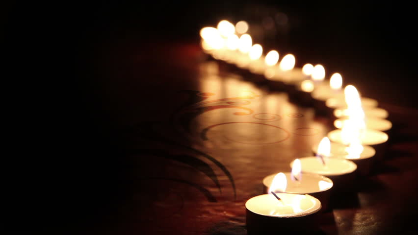 little candles lined up light up one by one