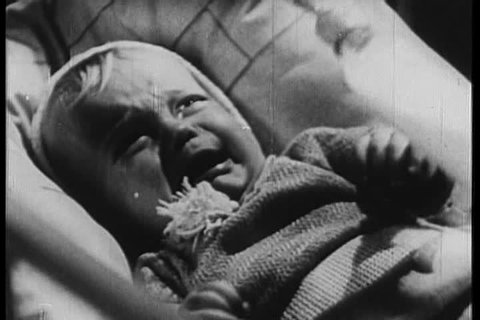 A mother gives her crying baby a toy, which comes to life in front of the baby\xCDs eyes. (1940s)