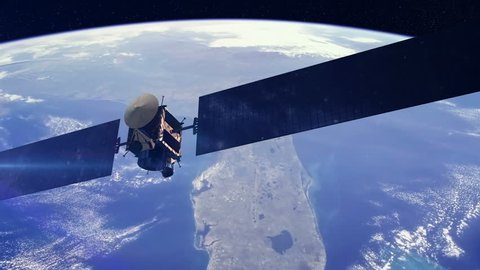 Communications satellite orbiting earth. Space and technology related concept.