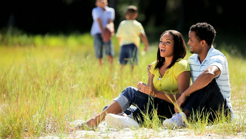 Young ethnic parents enjoying the park while young sons play | Shutterstock HD Video #1919164