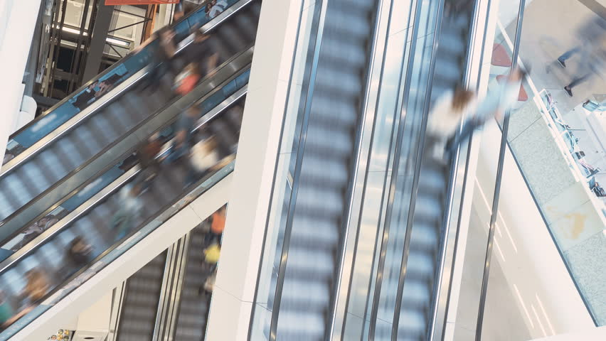 Time lapse of people riding escalators in a shopping mall | Shutterstock HD Video #19196404
