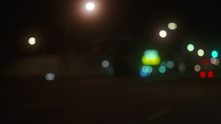 Night small town deserted street white Cadillac away from camera then dark Ford escort drive away Rack focus | Shutterstock HD Video #19234144