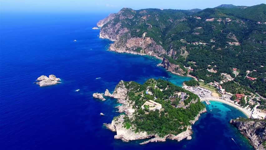 Flight over Paleokastritsa bay Greece Corfu aerial 4k travel video. Resort, ocean sea coast, clean blue water, rocky cliff shore