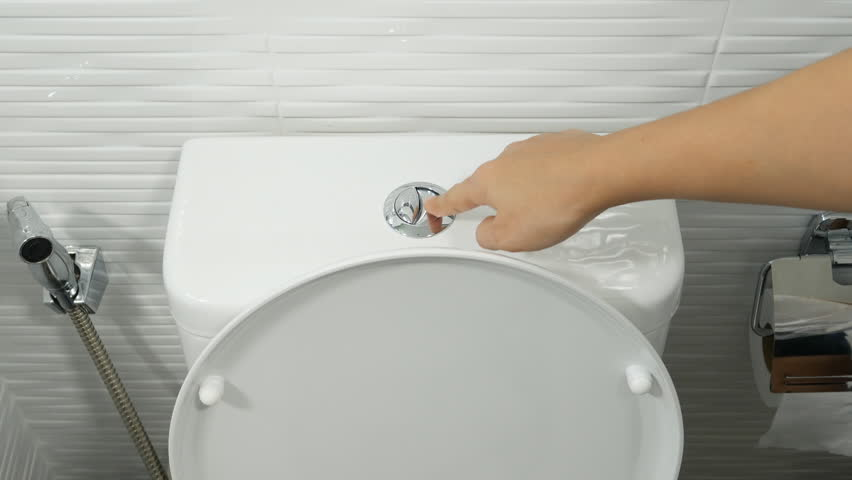 4K of finger pushing button and flushing toilet