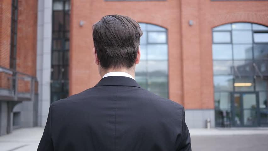 Walking Man in Suit, Back View | Shutterstock HD Video #19306744