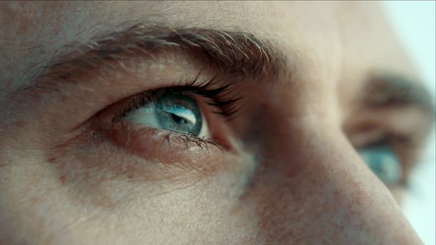 eyes closeup. Man sees at sunset / Slow motion