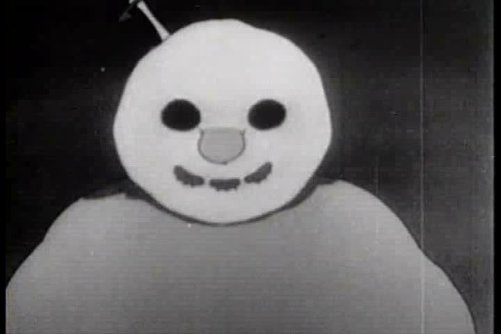 An Eskimo and his animal friends run from the snowman they created, who has inexplicably turned evil, in this cartoon from 1933. He succeeds in catching and eating a fish. (1930s) | Shutterstock HD Video #19411774